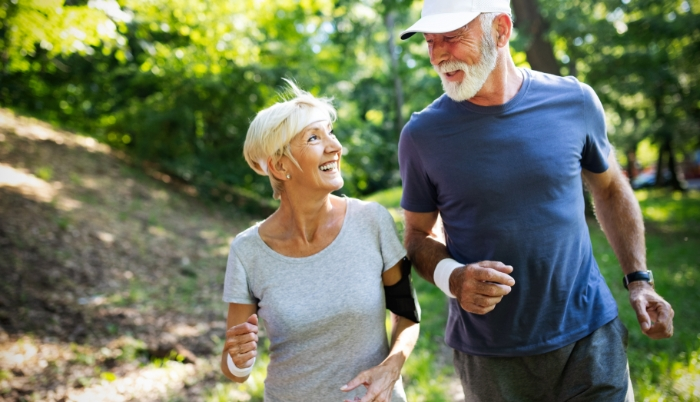 Older woman and man out for run